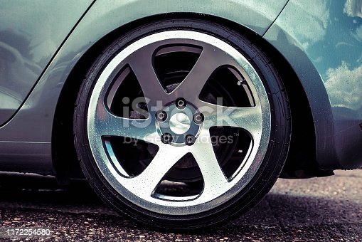 910009838 istock photo Alloy wheels of a sports car. Polished to shine. On a gray car. Close up 1172254580
