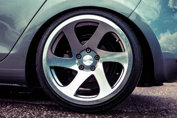Alloy wheels of a sports car. Polished to shine. On a gray car. Close up stock photo
