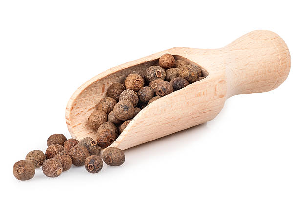 allspice in wooden scoop isolated on white background pimento peppercorns in wooden scoop isolated on white background. Whole allspice berries in wooden scoop. Myrtle pepper. Jamaica pepper. Spice of peppers in a wooden scoop allspice stock pictures, royalty-free photos & images