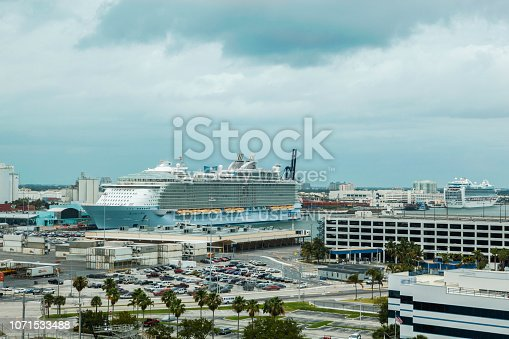 Baltimore, United States - April 07, 2013: Allure of the Seas is docked at Fort Lauderdale Harbor. This cruise ship is owned and operated by Royal Caribbean International. You can see the parking with cars, containers, the terminal, boats and another cruise ship.