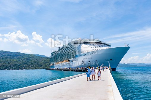 Labadee, Haiti - October 9, 2012: Passengers disembark the Royal Caribbean Cruise ship the Allure of the Seas for a day of beach activities. With a passenger capacity of over 8 thousand, the Allure of the Seas is the largest cruise ship in the world to date.