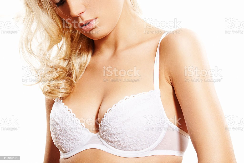 Alluring blond woman model in beautiful white lingerie bra stock photo