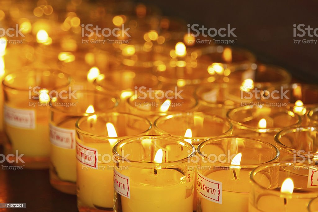 Allusions  Candles at a Buddhist temple royalty-free stock photo