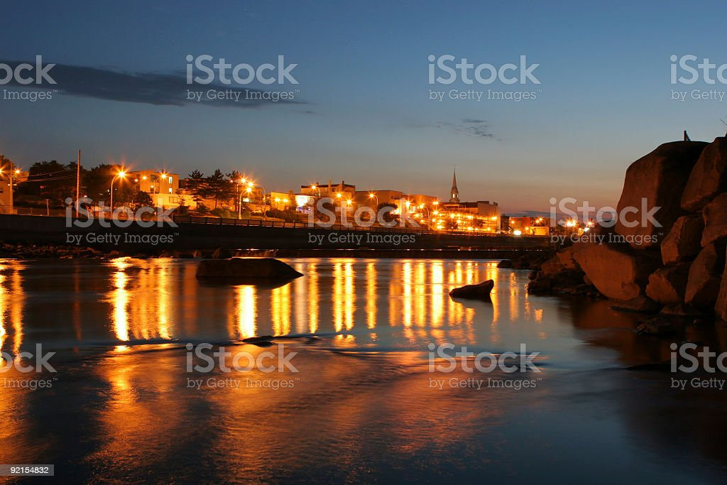 Alma city and the Saguenay river in the evening royalty-free stock photo
