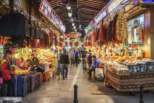 A bazaar is a permanently enclosed marketplace or street where goods and services are exchanged or sold. Almaci bazaar is located in Şehitkamil district of Gaziantep, Turkey. Local dried food and spices are sold in this bazaar. People in this image are shop owners or local people shopping.