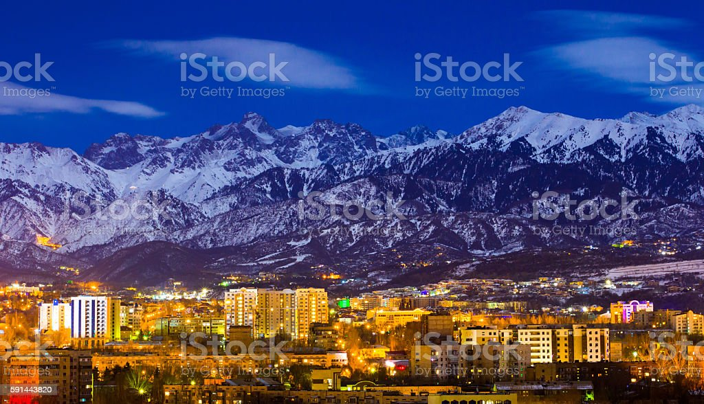 Almaty and mountains under the moonlight stock photo