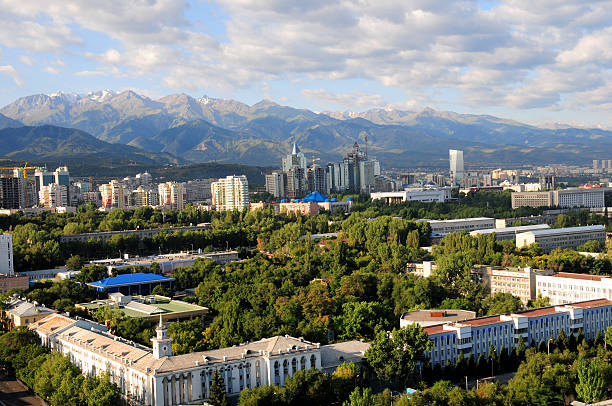 Almaty skyline Panoramic view of Almaty city in Kazakhstan with a beautiful mountain range in the background. kazakhstan stock pictures, royalty-free photos & images