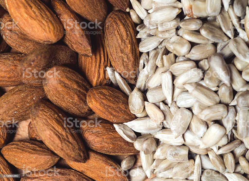 Almond and sunflower healthy seeds background stock photo