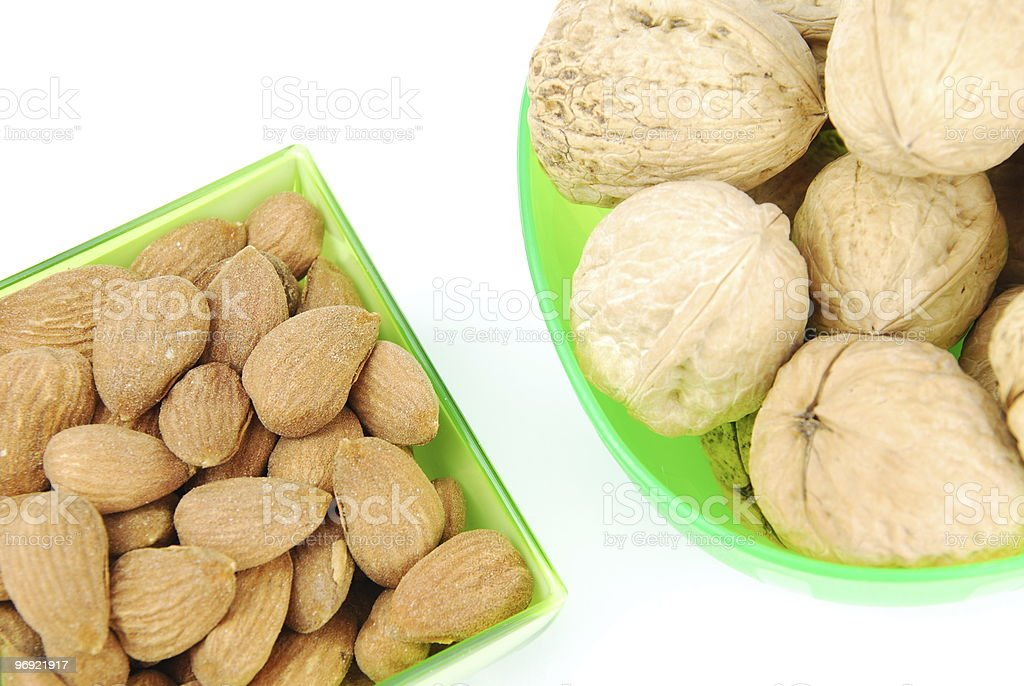 Almond and walnuts on green cups royalty-free stock photo