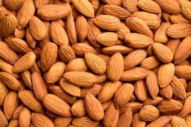almond, backgrounds, nut - food, textured, harvesting - mandorla foto e immagini stock