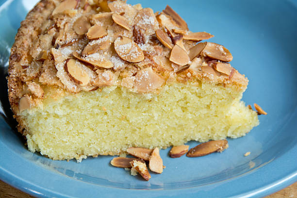 Almond cake on a blue plate stock photo
