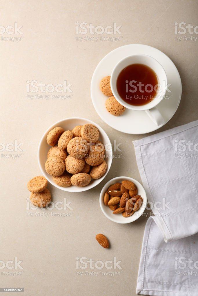 Almond cookies in bowl and tea, food above stock photo