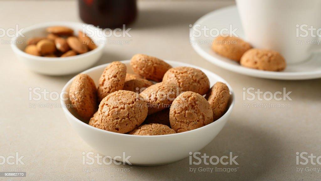 Almond cookies in bowl, food closeup stock photo