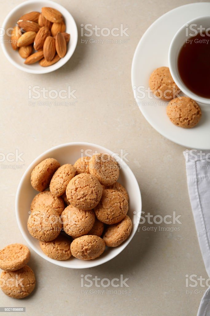 Almond cookies in white bowl, food closeup stock photo
