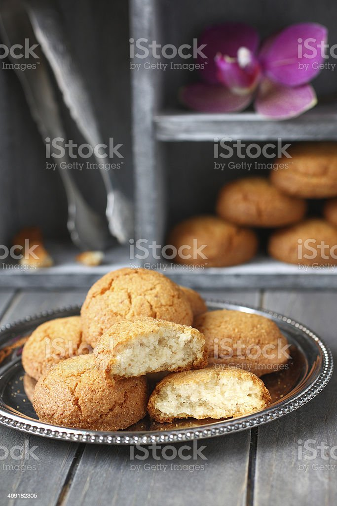 Almond cookies with sugar tongs and orchid flower stock photo
