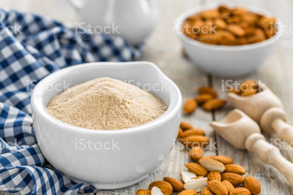 Almond flour and nuts stock photo