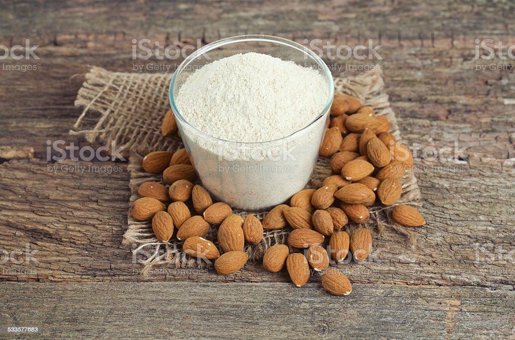 almond flour on wooden surface stock photo