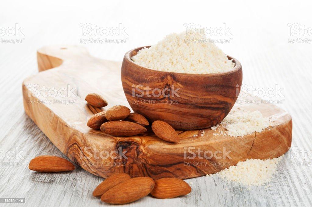Almond flour with almonds stock photo
