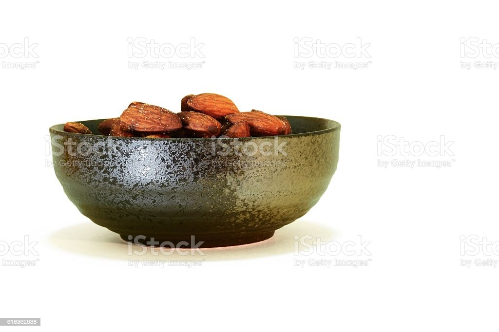 Almond in black bowl stock photo