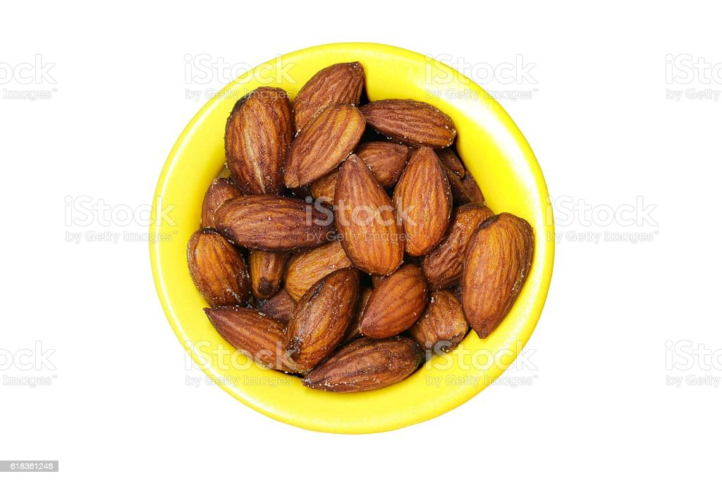 Almond in yellow bowl stock photo