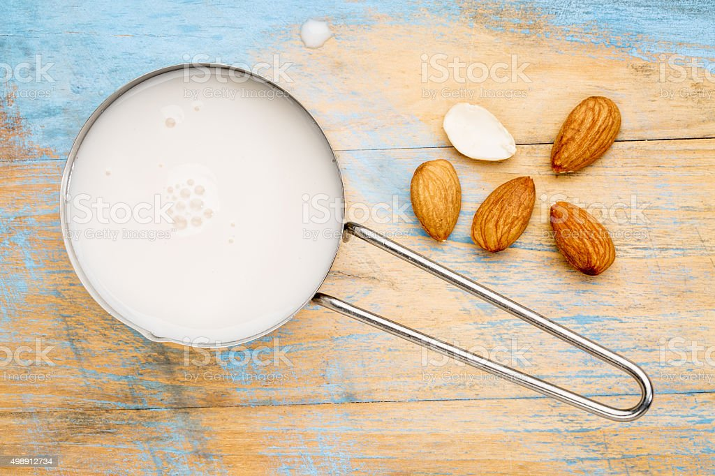 almond milk and seeds stock photo