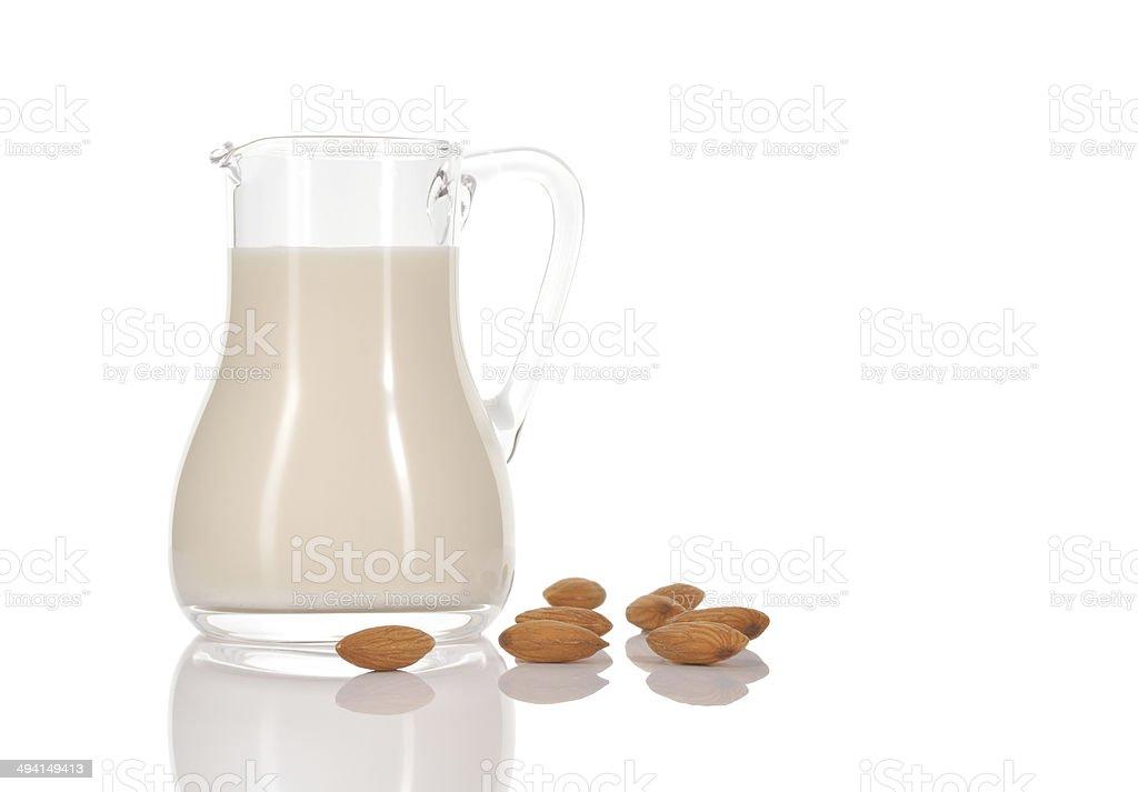 Almond milk in jug on white background. stock photo