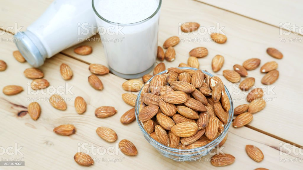 Almond milk on a wooden table. stock photo