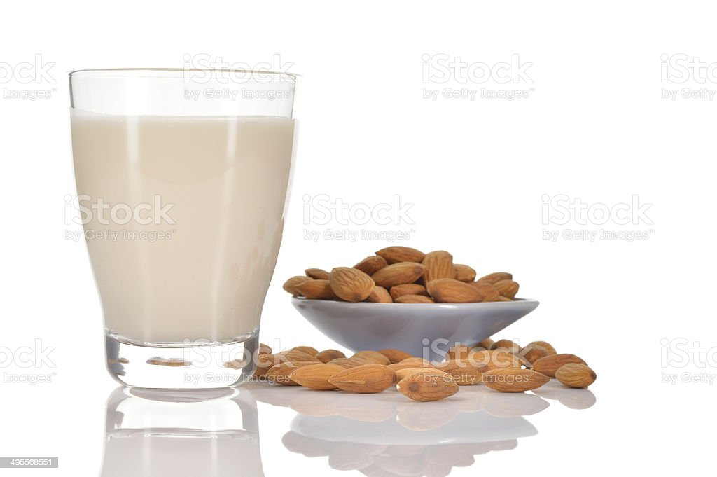 Almond milk on white background. stock photo