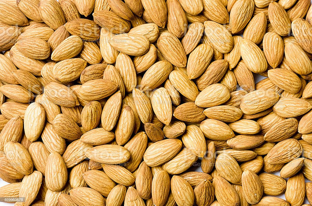 Almond nuts arranges as background stock photo