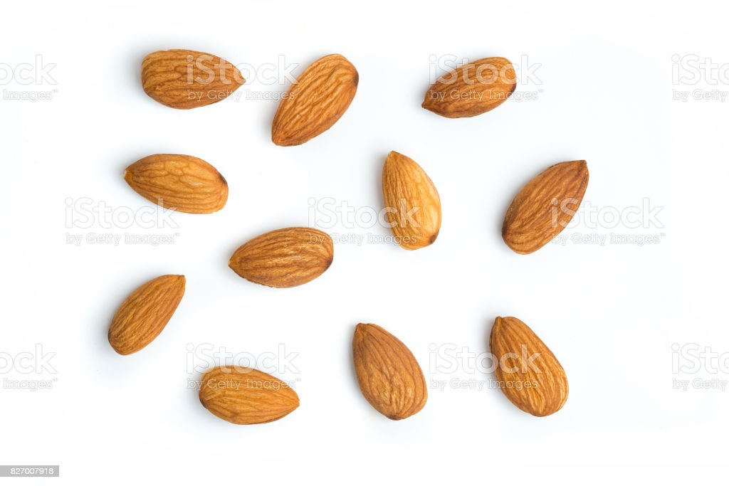 Almond nuts on isolated white background stock photo