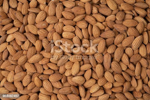 istock Almond nuts pile background. 953462452