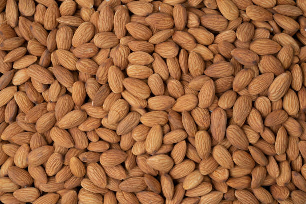 Almond nuts pile background. stock photo