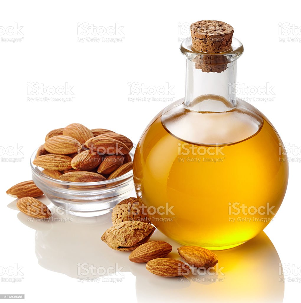 Almond oil and almonds stock photo