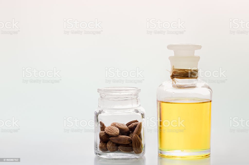 Almond oil in bottle stock photo