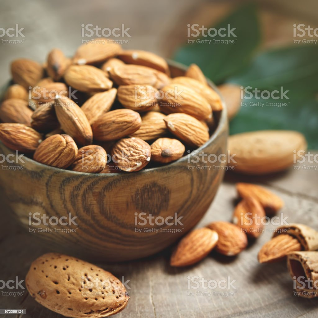 Almond on a wooden table in the summer garden. Useful food stock photo