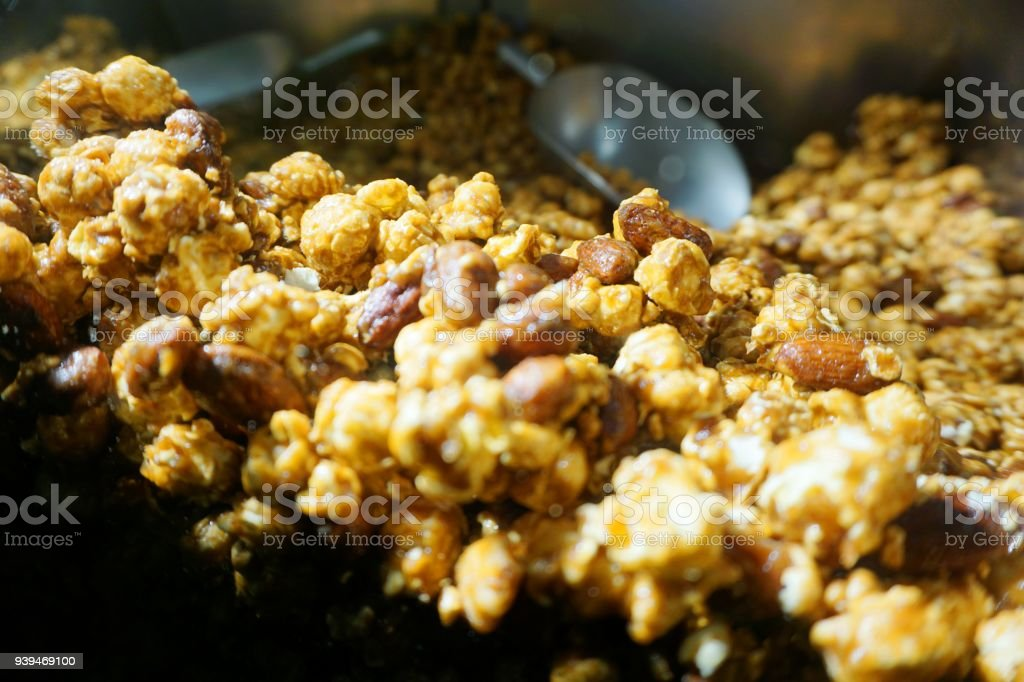 Almond Popcorn with Metal Scoop stock photo