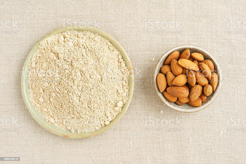 Almond seeds and almond flour stock photo