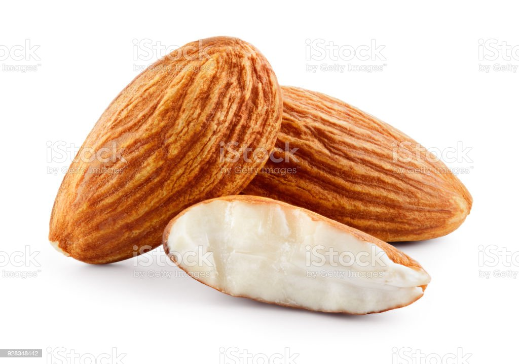Almond. Three almond nuts isolated on white. Full depth of field. stock photo
