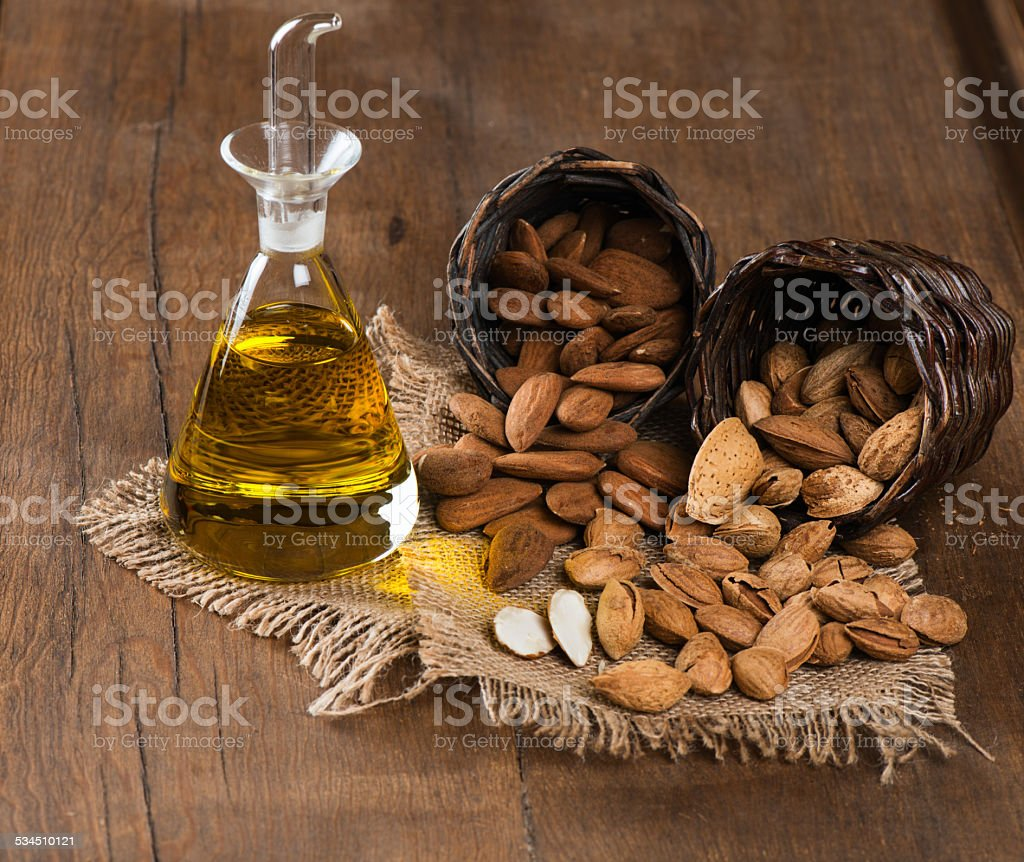 Almonds and almond oil stock photo