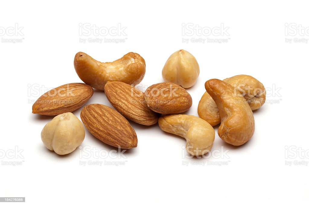 Almonds and cashew nuts on a white background stock photo