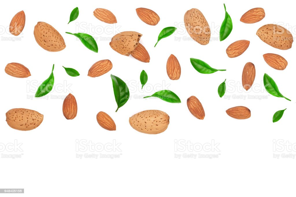 almonds decorated with leaves isolated on white background with copy space for your text. Top view. Flat lay pattern stock photo
