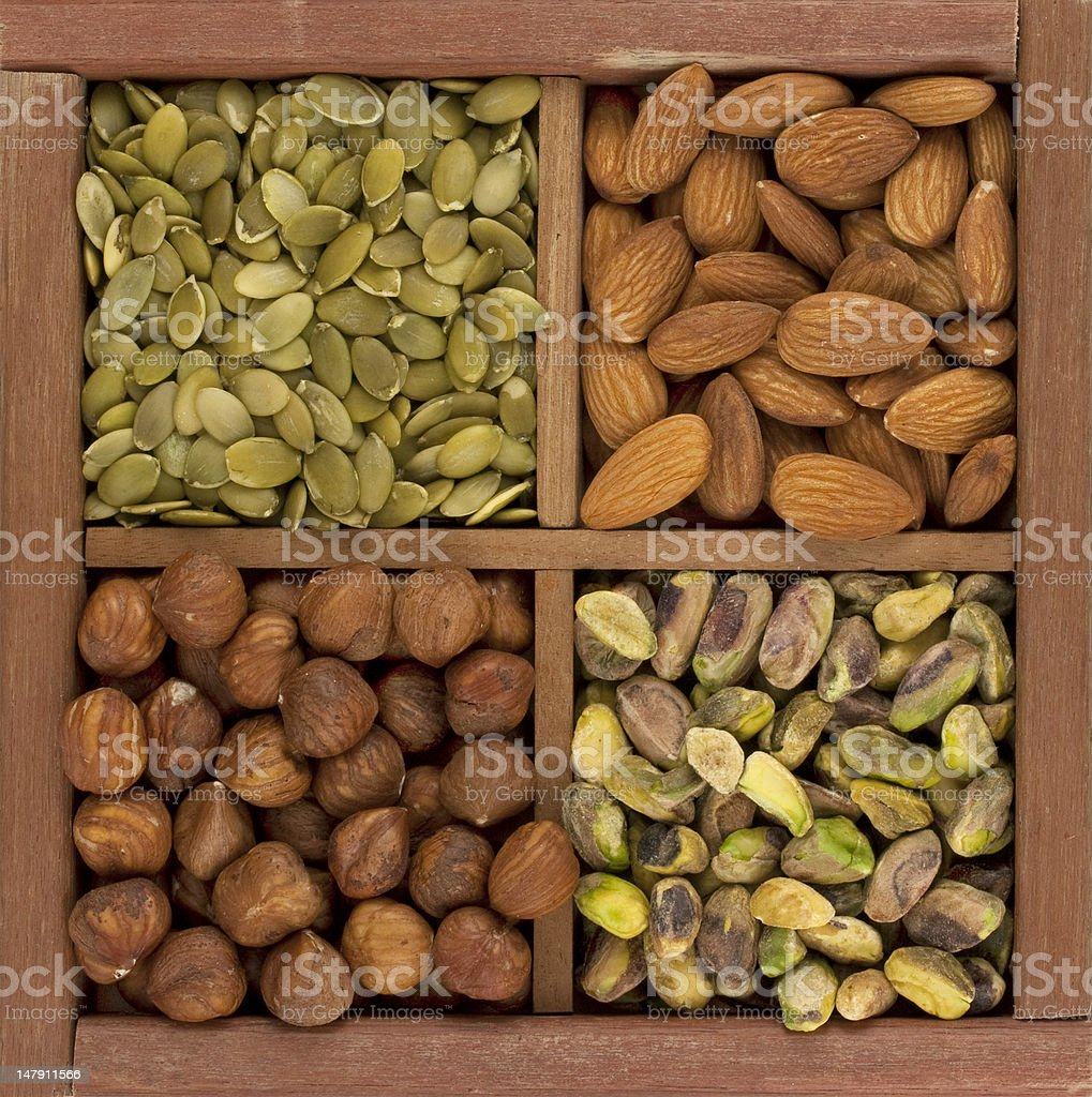 almonds, hazelnuts, pistachio nuts and pumpkin seed royalty-free stock photo