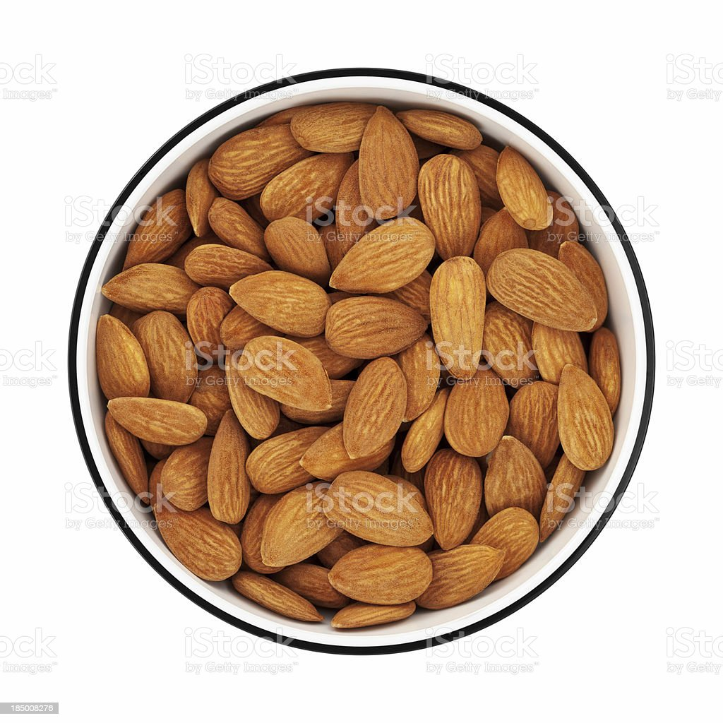 Almonds in a bowl from directly above stock photo