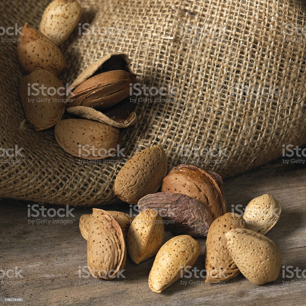 Almonds in a burlap sack royalty-free stock photo