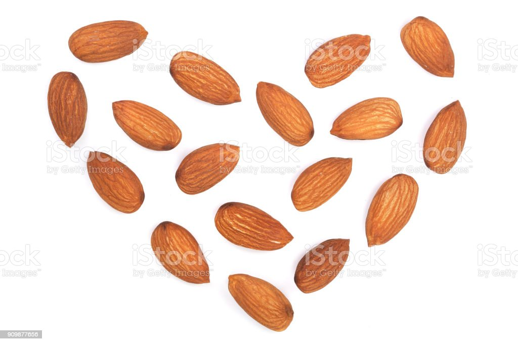 almonds in the shape of a heart isolated on white background. Top view. Flat lay pattern stock photo