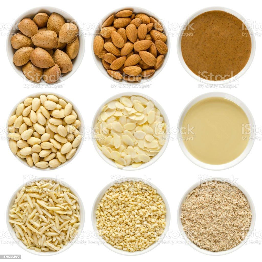 Almonds in white bowls over white stock photo