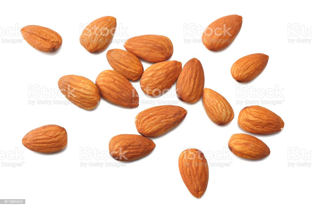 almonds isolated on white background top view stock photo