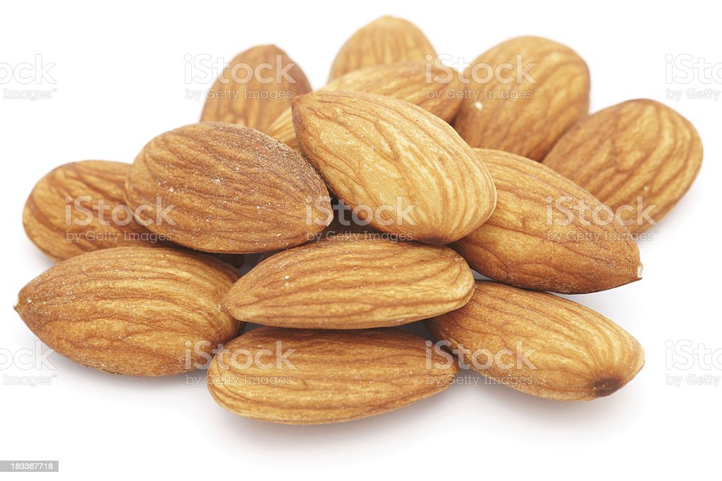 Almonds isolated on white - closeup royalty-free stock photo