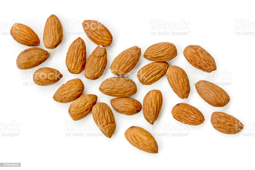 Almonds Isolated on White Scattered Top View stock photo
