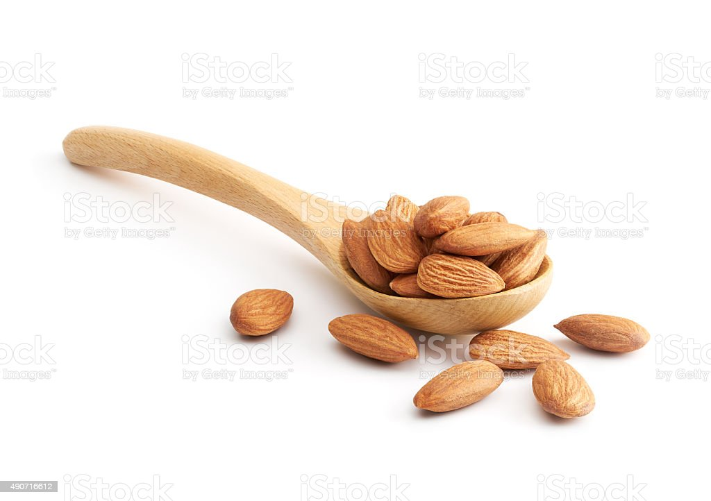 Almonds on Wooden Spoon stock photo